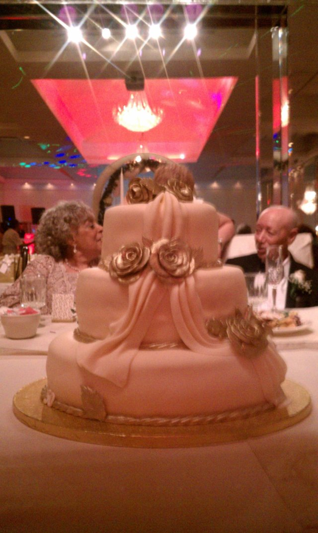 50th Wedding Anniverary Couple and Cake